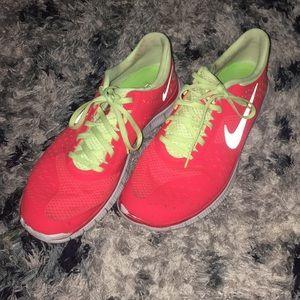 Orange and neon yellow Nike running shoes